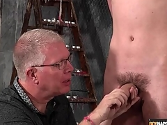 Grown up BDSM authority gives twink a handjob