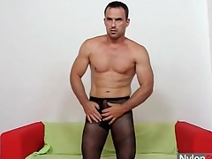 Muscular man in pantyhose fucks a toy